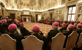 Pope Benedict XVI addresses cardinals in the Clementine Hall at the Vatican December 21, 2007. Pope Benedict repeated on Friday the Vatican's willingness to have a constructive dialogue with China's communist government. In Christmas greeting with cardinals, the Pope spoke of a letter sent in June to China's Catholics, who are split between those in a state-backed patriotic church and those who worship in a so-called underground church loyal to him. REUTERS/Danilo Schiavella/Pool      (VATICAN)