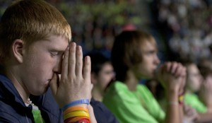 Dan Raftis, 15, from St. Patrick Church in Owego, N.Y., prays after receiving Communion during the closing Mass of the National Catholic Youth Conference Nov. 23 at Lucas Oil Stadium in Indianapolis. More than 23,000 youths from across the country took part in the conference. (CNS photo/Sam Oldenburg, Catholic Courier) (Nov. 25, 2013) See stories slugged NCYC- Nov. 25, 2013.